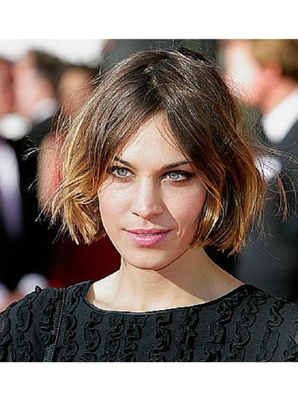 Taglio capelli scalati media lunghezza mossi