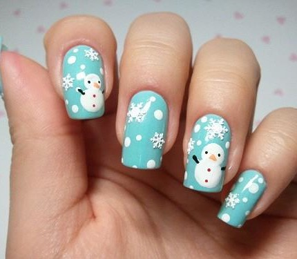 Blue-Nails-With-White-Snowflakes-And-Snowman-Christmas-Nail-Art